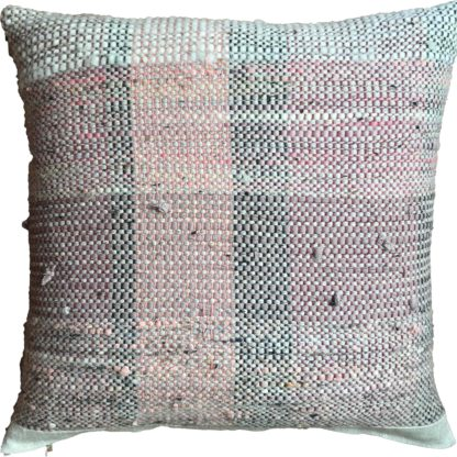 delicate pale pink striped cushion on a natural linen background.