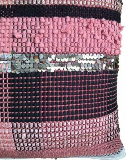 detail of pink and black striped cushion with sequins