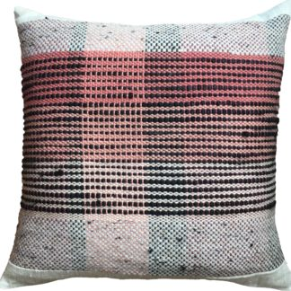 pink and black striped cushion on a linen background